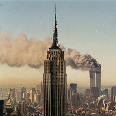 Twin Towers of the World Trade Center Burn Behind the Empire State Buildiing, September 11, 2001 Photographic Print