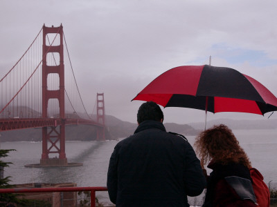 Tourists Use an Umbrella During a Light Rain, Looking at the Golden Gate Bridge in San Francisco Photographic Print