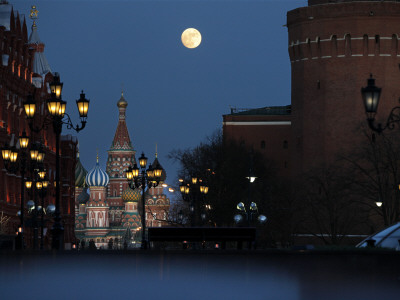 Moon is Seen over the Red Square in Moscow with the St. Basil Cathedral in the Background Photographic Print