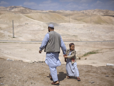 Palestinian Father and Son Walk in Desert During Celebrations Marking the Annual Day of Nebi Musa Photographic Print