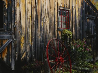 Wheel Besides Barn, Drury Place, Weston, Vermont, USA Photographic Print by Scott T. Smith