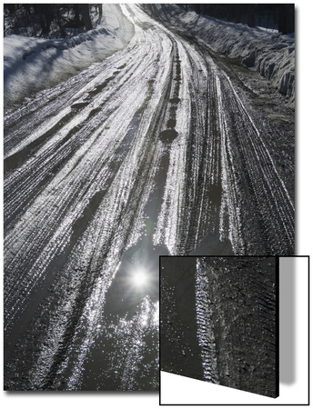 Muddy Wet Road Reflecting the Sunlight Poster by John Churchman