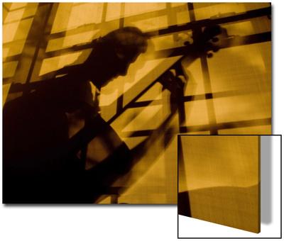 Shadow of a Man Playing Guitar Posters by John Churchman