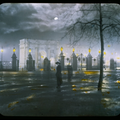 Marble Arch by Night - a Figure Standing in Front of the Park Gates Photographic Print
