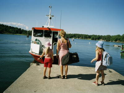 A Woman and Two Little Girls Waiting for a Boat on a Dock Photographic Print
