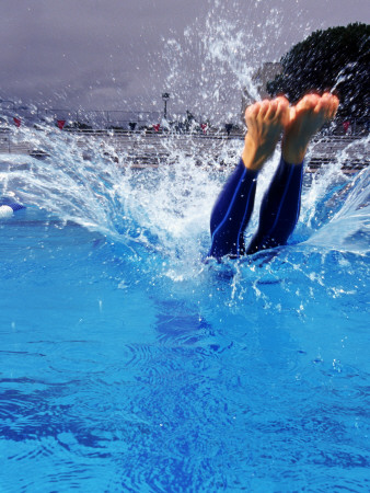 Female Swimmer Diving into Pool Photographie