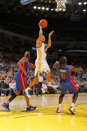 Detroit Pistons v Golden State Warriors: Stephen Curry and  Rodney Stuckey Photographic Print