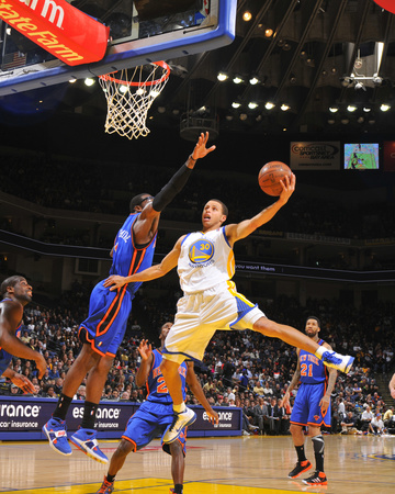 Stephen Curry dunk in Golden State Warriors white uniform against Amare Stoudamire New York Knicks basketball sports photo by Rocky Widner