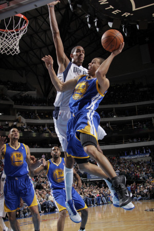 Stephen Curry dunk against Dallas Mavericks basketball sports photo by Glenn James