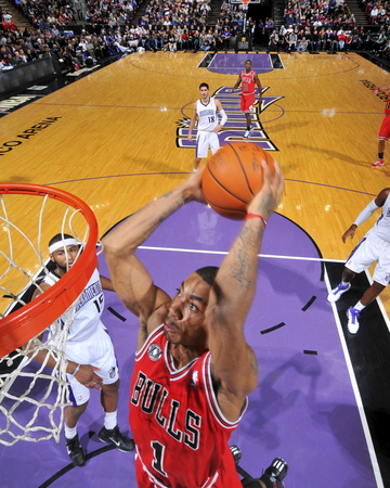 NBA Game - Chicago Bulls versus Sacramento Kings: Derrick Rose close-up dunk photo