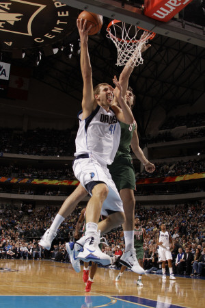 Milwaukee Bucks v Dallas Mavericks: Dirk Nowitzki and Andrew Bogut Photographic Print