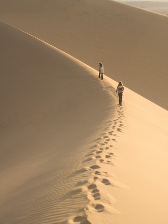 Teenagers Walk on the Mesquite Dunes Near Stovepipe Wells Photographic Print by Phil Schermeister