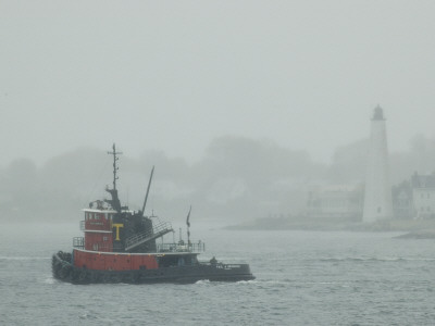 A Tugboat Travels Through Fog Past New London Harbor Light Photographic Print by Todd Gipstein