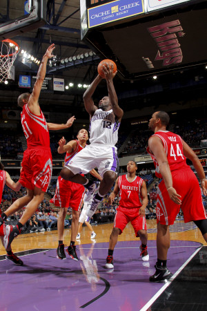 Houston Rockets v Sacramento Kings: Tyreke Evans and Shane Battier Fotografisk trykk