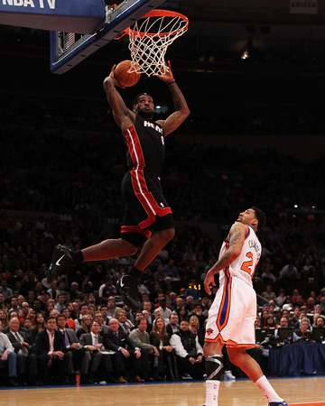 Photo of LeBron James dunking against Wilson Chandler, Miami Heat vs New York Knicks, photo by Al Bello