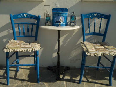 A Pair of Blue Chairs and a Table with Lamps and a White Stucco Wall Photographic Print by Richard Nowitz