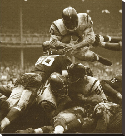Over The Top: The Redskins vs. The Giants, c.1960 Stretched Canvas Print by Robert Riger