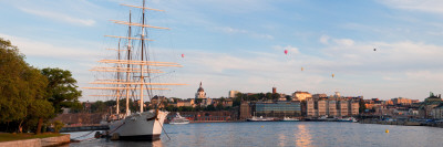 Schooner at Harbor with a City in Background with Hot Air Balloons in Sky, Stockholm, Sweden Wall Decal by  Panoramic Images