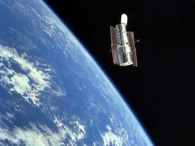 The Hubble Space Telescope with a Blue Earth in the Background Photographic Print by  Stocktrek Images
