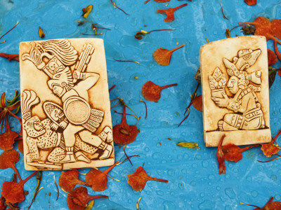 Souvenirs Depicting Mayan Figures at Chichen Itza Site Photographic Print by Guylain Doyle
