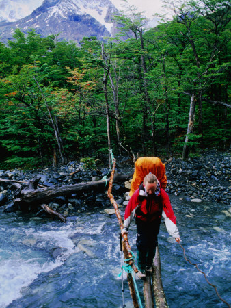 Hiker Crossing Rio Brian on Paine Circuit Trekking Route Photographic Print by Gareth McCormack