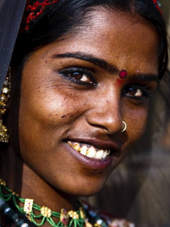 Portrait of Woman in Traditional Dress at the Pushkar Camel Fair Photographic Print by Kimberley Coole