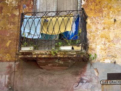 Clothes Hanging to Dry on Balcony on San Ignacio, Old Havana Photographic Print by Karl Blackwell