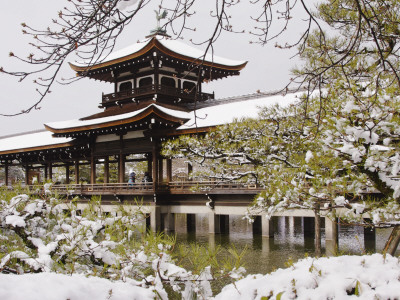 Snow Covered Chinese Style Bridge over Pond in Garden of Heian Shrine Photographic Print by Frank Carter