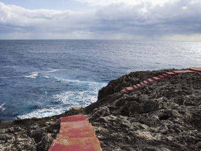 Red Stairs on Black Rocks Photographic Print by Holger Leue