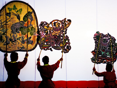 Performance of Nang Yai (Large Shadow Puppets) at Wat Khanon Temple Photographic Print by Carol Wiley