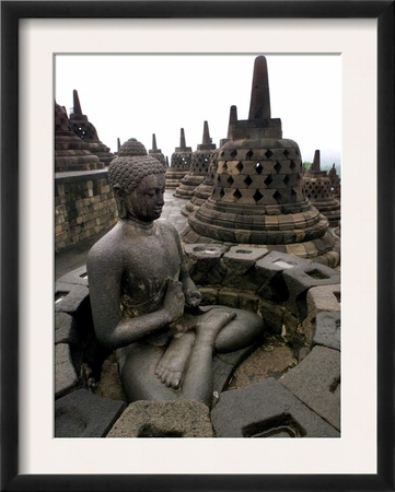 A Statue of Buddha Sits on a Terrace Framed Photographic Print by Dita Alangkara