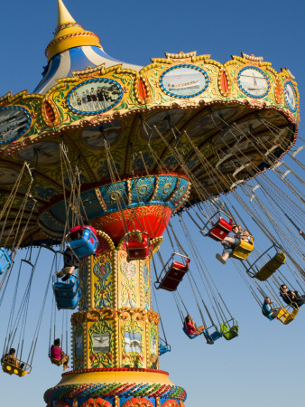People Riding on Sea Swings at Santa Cruz Beach Boardwalk Amusement Park Photographic Print by Sabrina Dalbesio