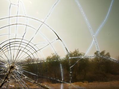 View Through Broken Window of Bus Photographic Print by Sabrina Dalbesio