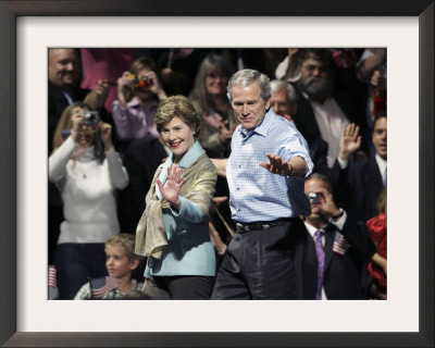 President Bush, Right, and First Lady Laura Bush Arrive for a Rally for Texas Governor Rick Perry Framed Photographic Print by Lm Otero