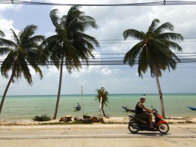 Motorcyclist Driving by Northern Coast of Ko Samui Photographic Print by Austin Bush
