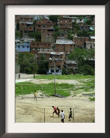 Venezuelan Children Play Soccer at the Resplandor Shantytown Framed Photographic Print