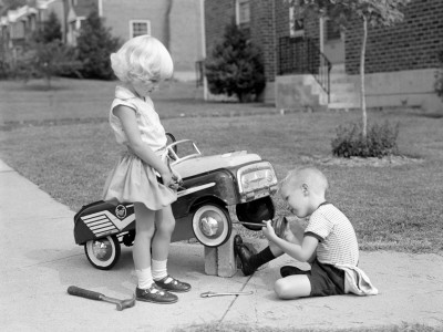 Children on Suburban Sidewalk, Boy Playing As Mechanic, Oiling Toy Pedal Car Photographic Print by H. Armstrong Roberts