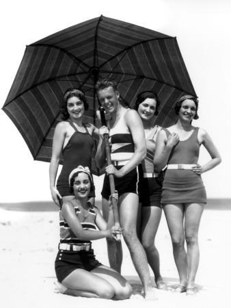 Four Women and One Man Under Beach Umbrella in Bathing Suits Photographic Print by H. Armstrong Roberts