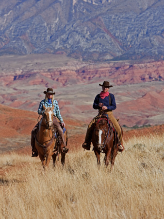 Cowboy and Cowgirl Riding Through Scenic Hills of the Big Horn Mountains, Shell, Wyoming, USA Photographic Print by Joe Restuccia III