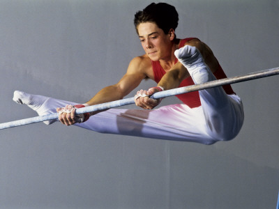 Male Gymnast Performing on the Horizontal Bar Photographic Print