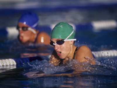 Female Swimmers Competing in a Breaststroke Race Photographic Print