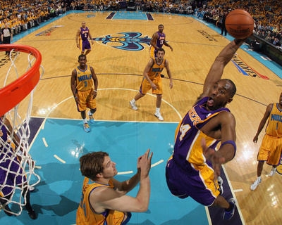 LA Lakers vs New Orleans Hornet - Kobe Bryant dunking over player Game 3, April 22 2011 NBA Playoffs - sports basketball photo poster by Chris Graythen