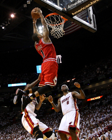 NBA May 24th Game: Chicago Bulls versus Miami Heat - Game Four, Miami, FL - Derrick Rose dunk on LeBron James and Udonis Haslem, basketball photo