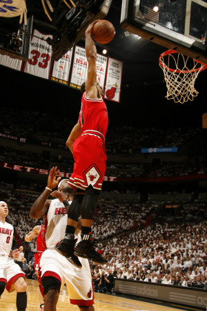 May 24th NBA Game: Chicago Bulls versus Miami Heat - Game Four, Miami, FL - Derrick Rose dunk on LeBron James photo