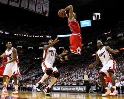 NBA May 24th Game: Chicago Bulls versus Miami Heat - Game Four, Miami, FL - Derrick Rose dunk on LeBron James and Mario Chalm, basketball photo