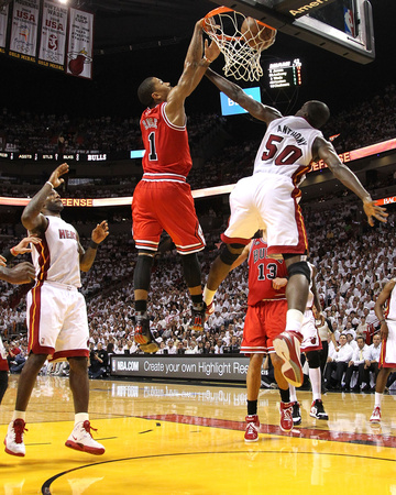 May 24th NBA Game: Chicago Bulls v Miami Heat - Game Four, Miami, FL - Derrick Rose dunk, Joel Anthony and LeBron James try to block basketball photo