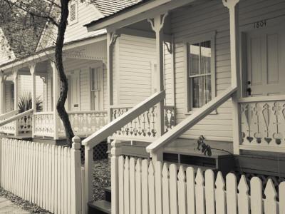 USA, Florida, Tampa, Ybor City, Cuban Heritage Area, Centennial Park, Row Houses Photographic Print by Walter Bibikow
