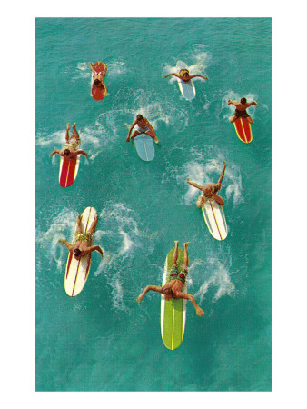 Surfers Paddling on Multi-Colored Boards, from Above Poster