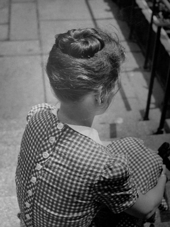 A Woman Showing Her Fashionable Upsweeping Hairstyle Premium Photographic Print