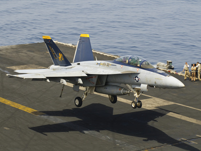 An F/A-18E Super Hornet Trap Landing on the Flight Deck of USS Harry S. Truman Photographic Print